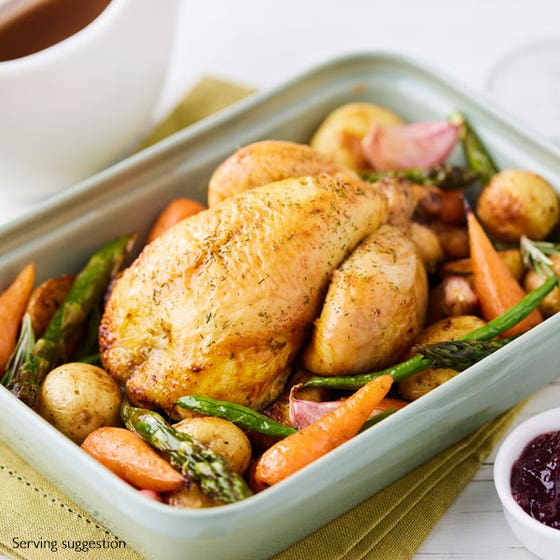 cooked poussin in white dish