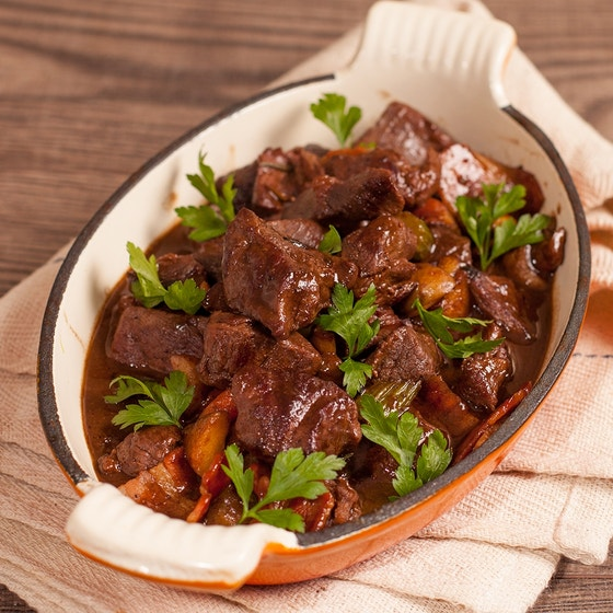 cooked red deer venison in white dish