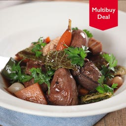 cooked diced game birds on white dish