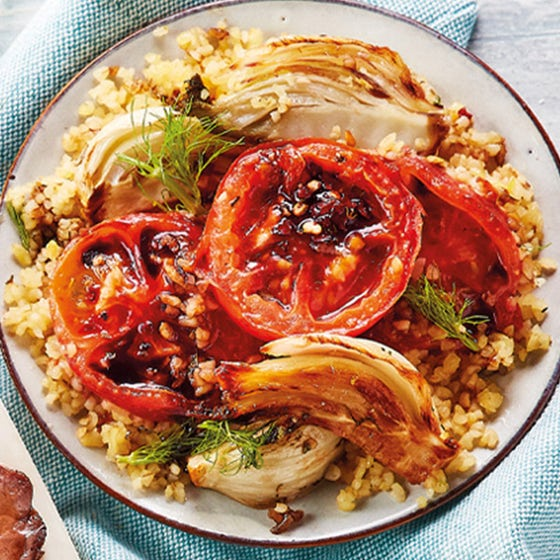 roasted fennel and tomato salad with lemon on white plate