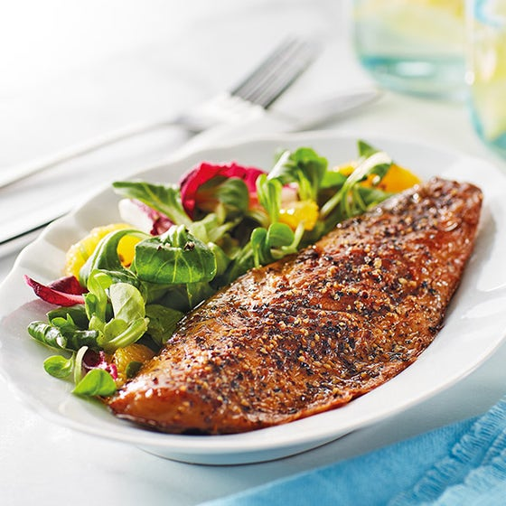 peppered mackerel with salad on white dish