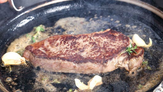 Cook steak on both sides and flip with tongs