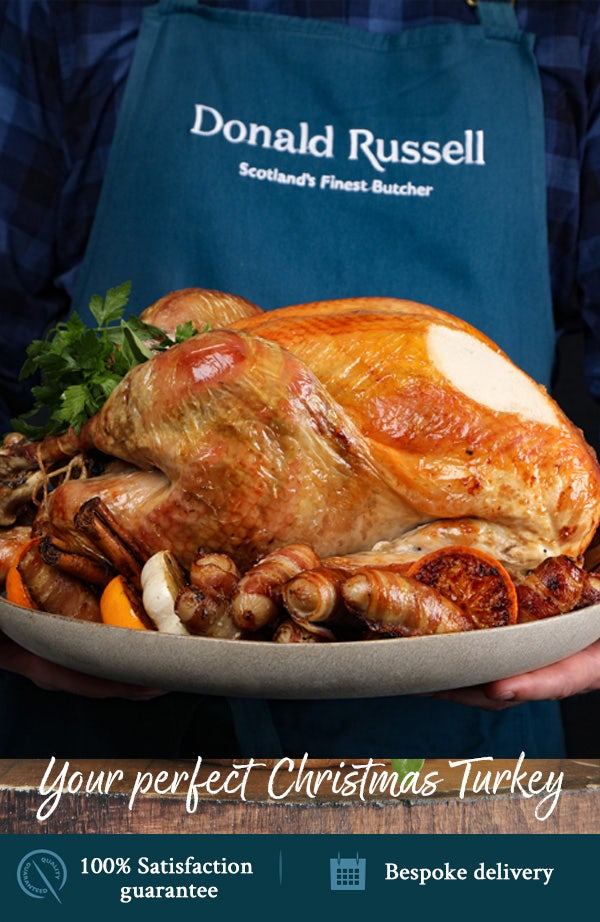 Chef holding Donald Russell turkey